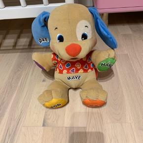 Fischer Price hund med lyd og musik. Kan spille melodier og tale. Pæn stand.  Køber betaler Porto med dao.