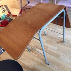 Rullebord hvor siddernw kan slåes op
