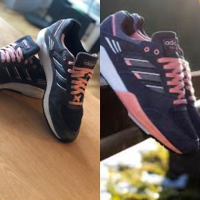 Det lyserøde er røget af efter spritning af skoene se billedet 41 1/3