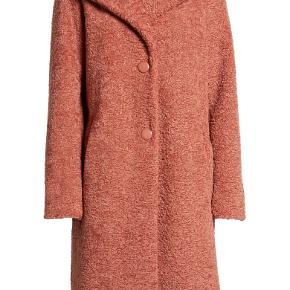 The brand is Halogen, Faux Fur Coat is the style and I purchased this at Nordstroms in the US.  This furry longline coat lends luxurious texture and charm to your chic, cold-weather look. The color is not exactly muave but with brown tones in it.  The colors are nice for fall, winter and spring. It's a size small but a medium may be able to wear it too.  It's versatile. I wore it once and have not since that time.  I am 155cm and I feel that this may be a bit too long for me.  It's a lovely coat but I bought another one that fits better in length for me.  Front button closure Notched lapel Long sleeves Side pockets Lined 100% polyester faux fur Dry clean Imported Coats