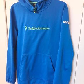 Klassisk sport-hoodie fra Peak Performance i størrelse M. Købt i København.