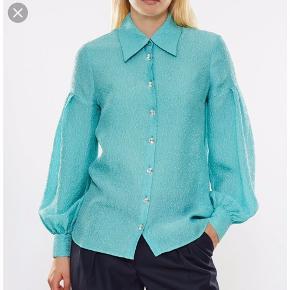 Virkelig en smuk skjorte.   Mindstepris er omkring 700 kr.