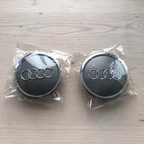 Helt nye grå Audi centerkapsler. 69mm lås 55mm. 4 stk 180 kr. Husk at være sikker på målene.