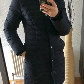 Long navy coat with down and father. Faux fur hood.