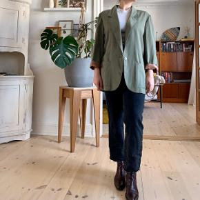 Vintage green and brown blazer. Definitely worn but still with life left!