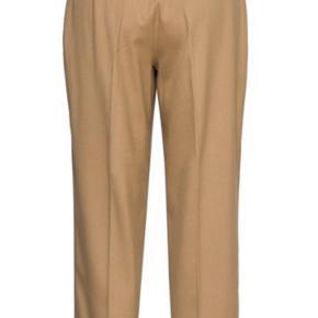 Tommy bukser  Har den i small og medium  Str svarende  Hel lange  Bytter gerne