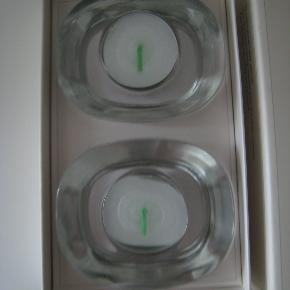 Fyrfadslysestager i glas fra Piet Hein. 2 styk helt nye fyrfadslysestager fra Piet Hein, i original æske, har aldrig været brugt. Kan evt. bruges som gave.