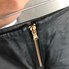 Lammeskind nederdel med guldlynåse