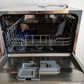 Wasco bordopvaskemaskine  Ca. 1 år gammel. Dog kun brugt i ca. 6 måneder Sælges udelukkende fordi jeg ikke har plads til den i min nye lejlighed.  Energiklasse: A+  Bredde: 55 Dybde: 50 Højde: 44