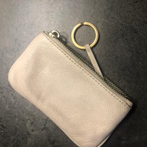 Sælger denne pung