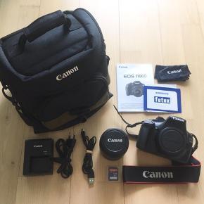 """Sælger mit Canon EOS1100D spejlreflekskamera efter køb af mindre kamera. Kameraet er knap nok brugt, da vi har flere herhjemme, og det er derfor som nyt.   Med kameraet følger: - Canon EOS1100D - 18-55mm objektiv - Batterioplader og USB-stick  - To SDHC hukommelseskort (8GB og 4GB) - Canon 100EG kamerataske  - Købsbevis (April 2014) - Pudseklud - Manual  - Evt. """"Den digitale fotohåndbog"""" af Doug Harman (+40kr.)  Jeg er åben overfor alle seriøse bud og spørgsmål vedr. kameraet. (:"""