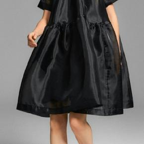 Black organza baby doll shape dress with side pockets and slip dress.