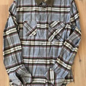 Varetype: Skjorte Farve: Blå ternet Oprindelig købspris: 1200 kr.