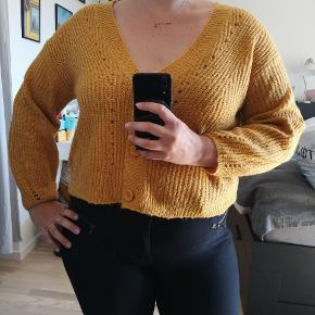 Cute yellow cardigan. Can be worn by L or M