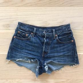 Tight dark blue denim shorts from Levi's. Size W24.
