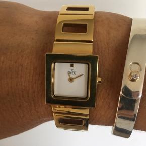 Fint enkelt ur fra Inex.  Brugt et par gange så i super fin stand.  Måler 17 cm.