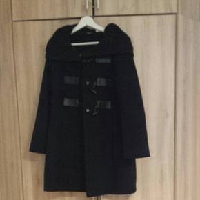 Doufle coat noir  La Redoute avec grande cappuche
