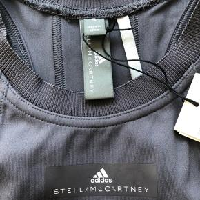 Never used sportswear top from Stella McCartney for adidas with cutout back. Fast price.