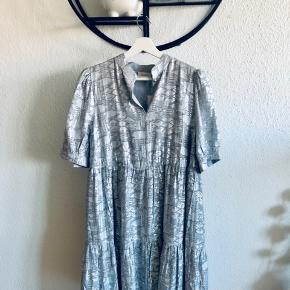 Completely new silver dress, loose fit, medium length