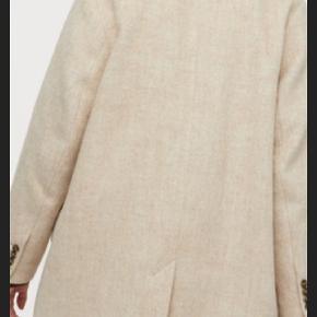 Lækker jakke med uld fra h&m.  Np 499,-