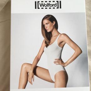 Smuk og elegant body (bodystocking) fra wolford i nude/pudder. Passer både en 34/xs og 36/small.