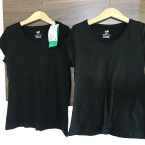 Prisen er for begge Basis t-shirts fra H&M str. 134/140 Den ene med mærke, den anden brugt enkelte gange  Prisen er excl. porto Bemærk, mine priser er faste. Handler gerne mobilepay på 26810990