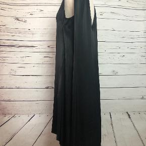 This dress can be worn with the v-neck in the front or back, for two different looks.  100% viscose.  Dry clean only.
