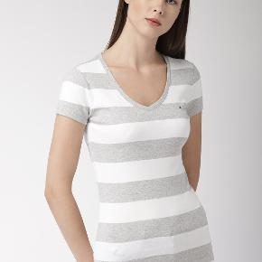 Light grey and white stripped fitted t shirt.  It's nice and thick with a v neck that gives it a feminine look. I have the black one for sale too. It says medium but I think it would fit a medium tight. It fits a small nicely.   #30dayssellout