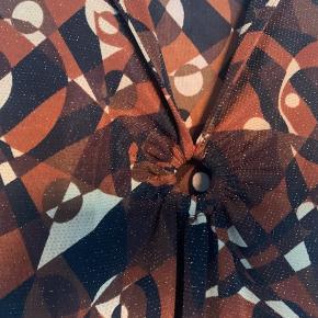 Vintage kjole fra mærket Che Fremstår som ny Størrelse medium/large