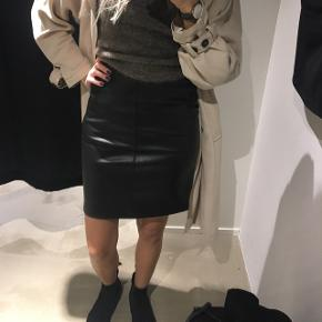Black leather look pencil skirt.