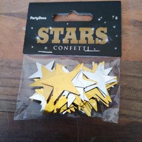 Bordpyndt konfetti, stjerner i guld og sølv mettalic. 7 g. 5 kr. Sender plus porto