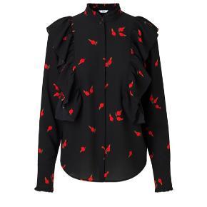 Fineste skjorte med flæser og mønster med hyben. Kun brugt få gange, fejler intet 💫  Byd gerne. Sendes med dao eller afhentes i indre by, København ☺️