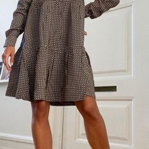 Beautiful a bit oversized dress from current collection. Brand new without tags. Never used.