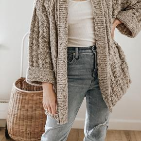 Beige blend heavy open cardigan with a slightly metallic thread running through. Perfect for working from home or the office.  Oversized. Easily fits a size Small.
