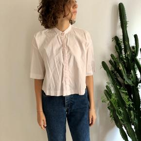 Light pink cotton shirt, cropped and really comfy.