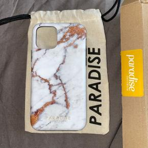 Cover fra Paradise Amsterdam til IPhone 11 Pro (modtaget d. 3/7 og er derfor ikke brugt!).  Coveret beskytter hele vejen rundt og har beskyttende cover inderst.   Købspris var 150,- — sælges da det er for dyrt at returnerer.  Kan sendes på købers regning eller afhentes i Viby J.