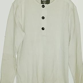 Dejlig beigefarvet strik fra H&M i 100% bomuld, brugt få gang og i fin stand.