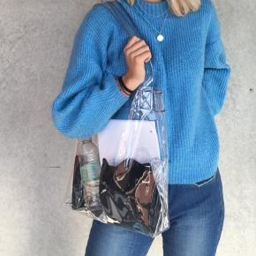 Sælger denne gennemsigtige taske!