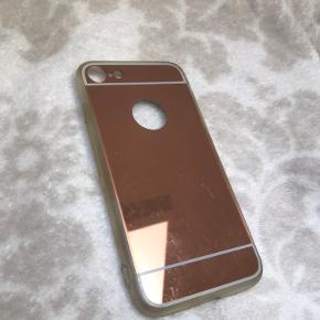 Rosa guld cover til IPhone 7. Bemærket venligst at der er nogle ridser på coveret