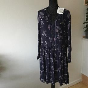 Beautiful dark blue with small pink flowers . New with tag on. Loose fit L size
