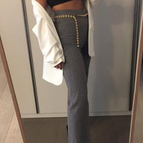 Straight gray trousers (with pockets), worn a couple of times. Fits size s-m
