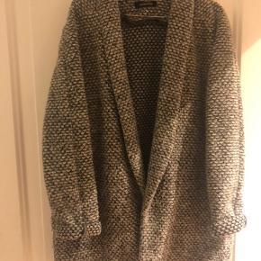Wacherhaud uldjakke i fin stand, brugt men stadig god. Fast pris. Kan være interesseret i bytte.