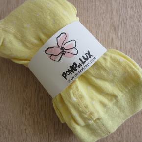 2 par gule Pompdelux strømpebukukser/leggings. Aldrig brugt. Sælges for 75 kr. pp, men KUN via Mobilepay.