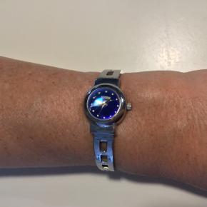 Storm dame ur brugt begrænset og i flot stand Uret fungerer perfekt og med nyt batteri