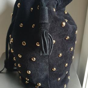 Sort ruskind tasker med niter