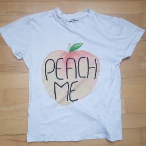 Fin hvid t-shirt fra Ganni i str. S. Ingen synlig slitage, fremstår pæn. 100% bomuld.