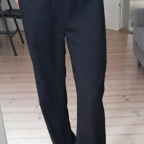 Inwear wide pants with pleat detail along sideseam