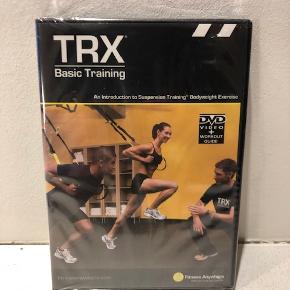 Trænings DVD/CD, TRX  Hvis du vil have det bedste ud af din TRX trainer, så er her en fin DVD, hvor du dels bliver inspireret til et hav af øvelser, dels får instruktion i, hvordan de skal udføres korrekt, så du får det optimale ud af træningen.  Original TRX trænings/instruktions DVD.  Aldrig åbnet. Stadig i orignalindpakningen (ubrudt cellofan).  God fornøjelse :)
