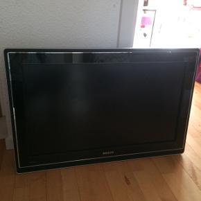 """LCD Philips cineos  fladskærm 32"""" med widescreen kan lyse med forskellige farver..virker og flot billedet på..er brugt på min datters værelse..virker så man kan se alm tv på det hvis der sættes boks til.."""