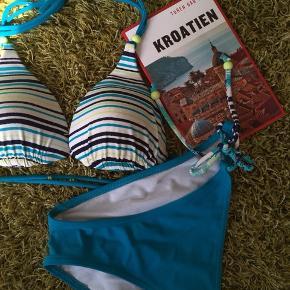Fin bikini fra Triumph, alt er justerbart. Brugt et par gange så der er nogle slidspor men ellers er den good to go 🌞